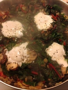 Eggs cooked in a nest of chard and mushrooms–easy and healthy!
